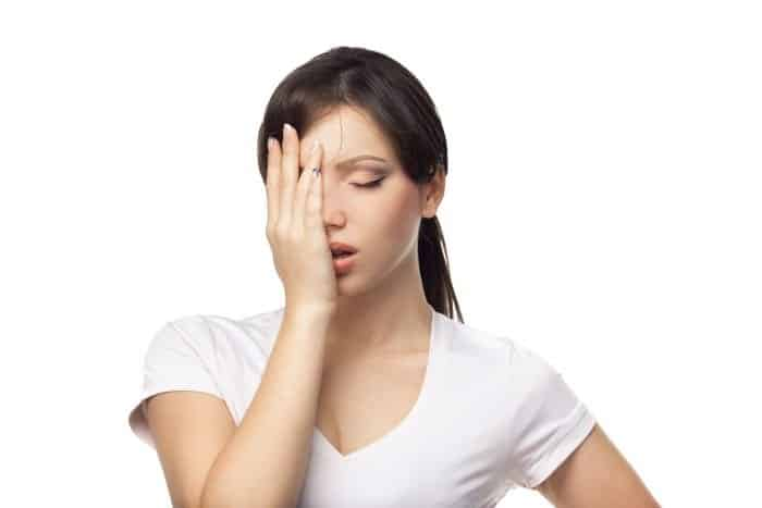 A frustrated woman in a white t-shirt