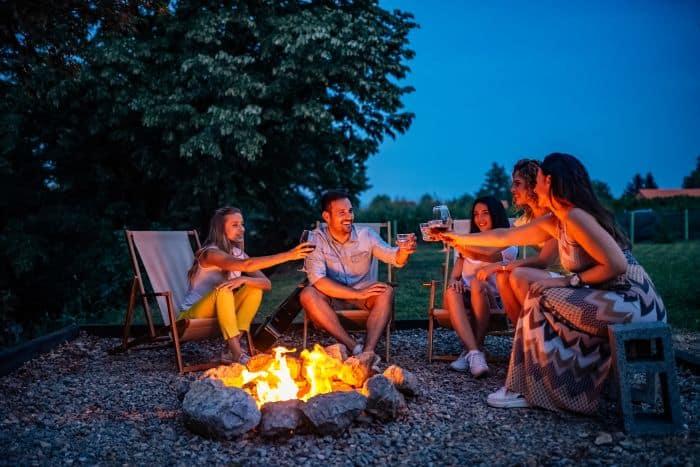 Group of friends enjoying near a campfire